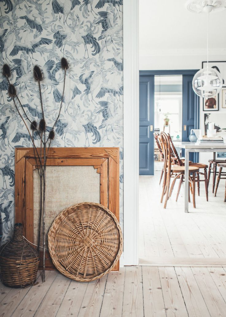 Blue wooden shutters and blue and white French wallpaper for relaxes Provençal style