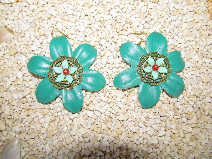 Handmade earrings (1 pair)  Made with leather flowers, metal filigrees, plastic flowers and glass beads.