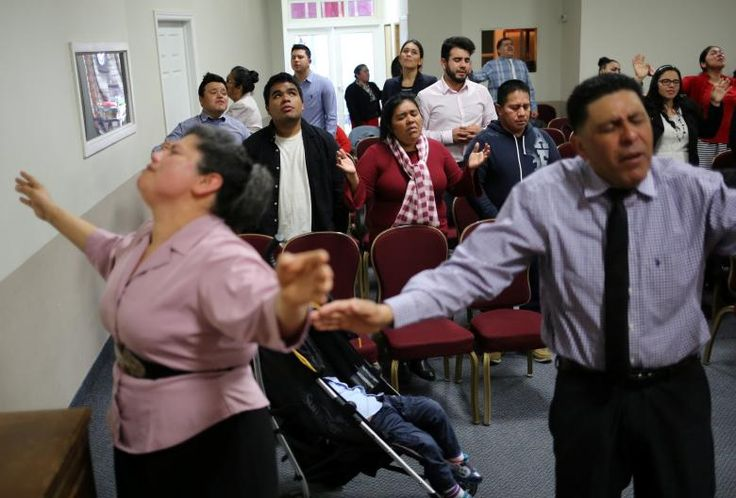 Honduran migrants Raul Contreras, his mother Daysi Alas (C) and step-father Ananin Cruz, who are seeking refugee status in Canada, attend a church service held in Spanish in Toronto.     REUTERS/Chris Helgren