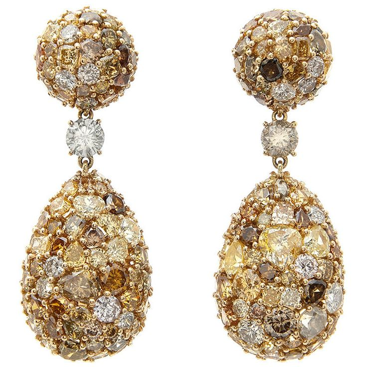 Yellow Diamond Drop Earrings, 20th Century.  A total of 28 carats of Multi-Colored Yellow Diamonds. One of the most spectacular yellow diamond drop earrings we've seen. Exceptionally eye catching with a total drop of almost two inches from the top of the round ball to the bottom of the pear shaped drop. Beautifully handmade rare earrings!