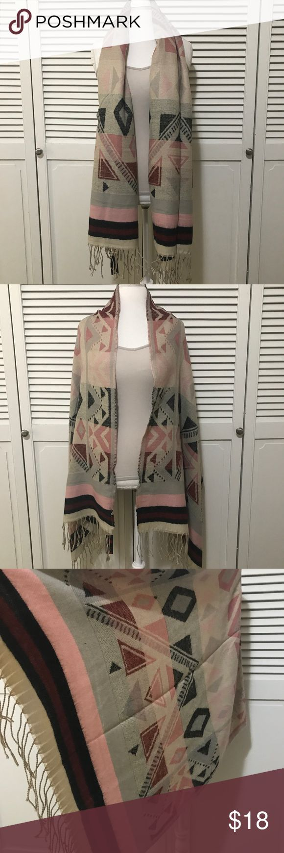 Beautiful Aztec Scarf Shawl with Tassel Accents ❤️ Beautiful Aztec Print Scarf with tassel detail. Can be worn as a scarf or shawl. Made of 100% Acrylic.   ❤️ Condition: New with tag. In original packaging.   ❤️ Fast Shipping (I ship daily!)  ❤️ Offers are always welcome! Lava Accessories Scarves & Wraps