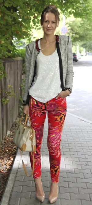 Tropical Print pant with Sequins top and tweed jacket and nude pumps.