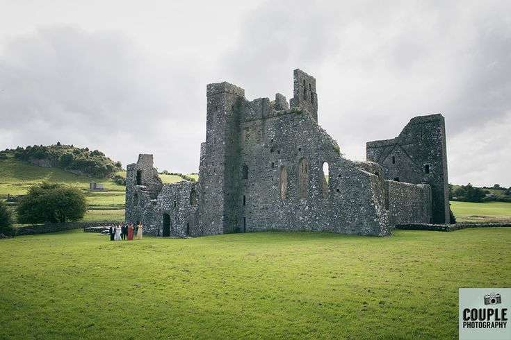 The bridal party take a stroll around the epic Fore Abbey in Westmeath. Weddings at Mullingar Park Hotel by Couple Photography.