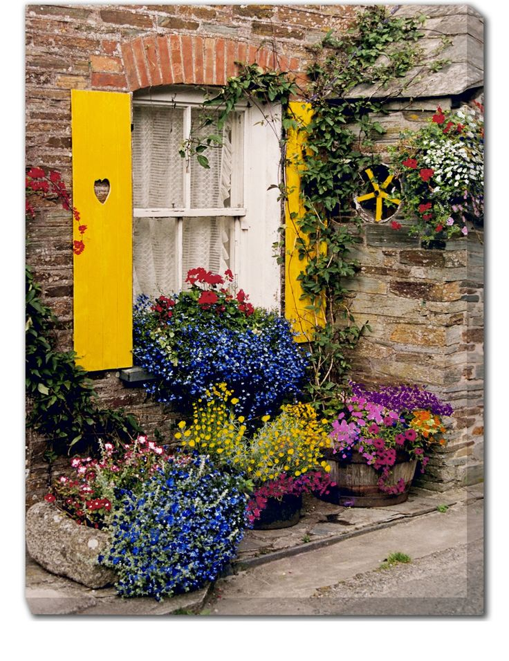 Polperro Outdoor Canvas Art Our Polperro Outdoor Canvas Art features a bright and cheery window with wooden shutters and a colorful garden of blooming flowers. Create your own oasis with our stunning,