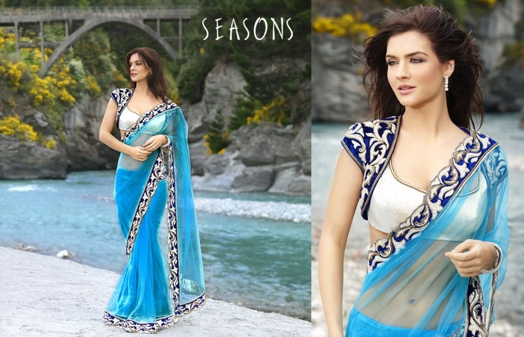 Blue. It's so beautiful I love there collection ♥  Hindu / indian bride Wear saree, lehenga, choli from seasonsindia. the model is Neha Dalvi or maria sokolovski
