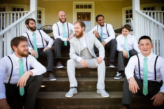 Hipster groomsmen in black pants, suspenders & Teal ties. Groom in light grey. From Brittany & Dave's coral & mint, DIY Virginia wedding. Images by Traci J Brooks Studios.
