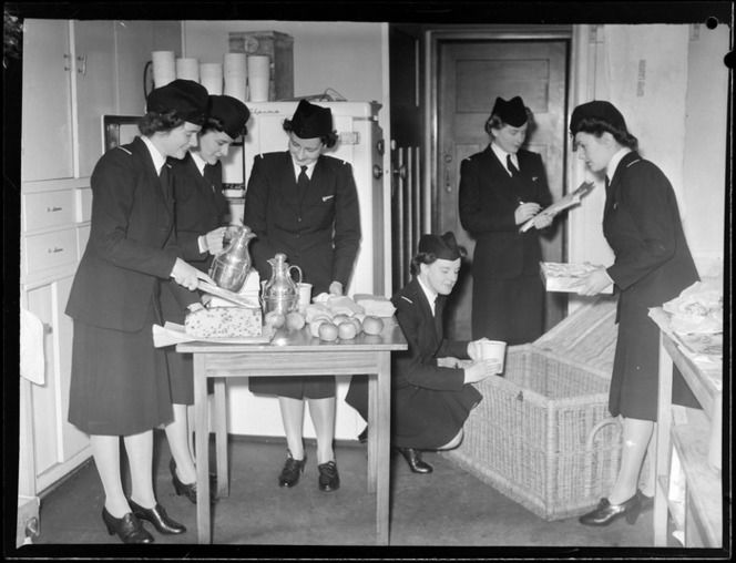 Unidentified Tasman Empire Airways stewardesses, studying food packing