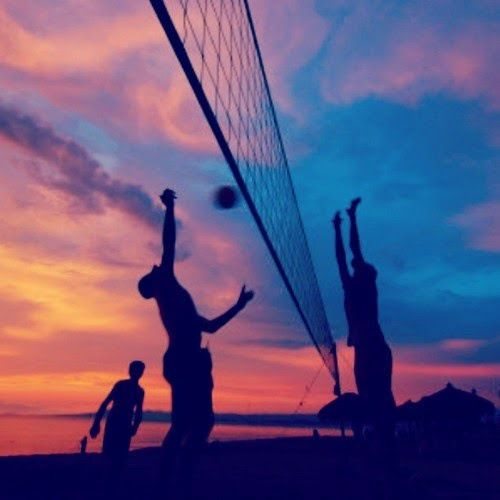 game of volleyball on the beach