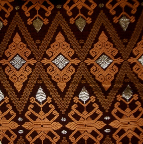 Balinese textile. Songket: The antique cloth will be attached with gold or silver threads then woven into beautiful patterns. Twenty years ago, Songket was only used by the royal family which indicate the wealth and status.