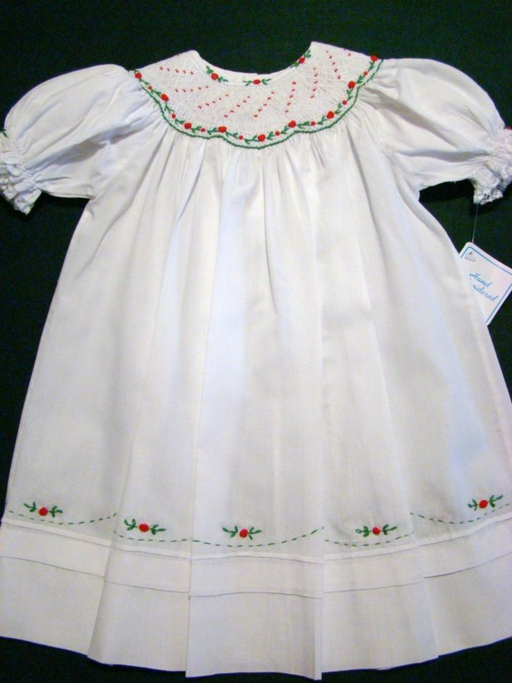 Embroidered cotton blend christmas dress has a lovely bishop smocked
