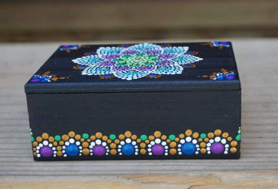 Beautiful Wooden Hand-painted Dot Mandala Treasure Jewelry Box with detailed sides! Box design is inspired my mermaids, flowers and Spring with blue, purple, green and gold details. Box has a removable top and the inside is painted blue. The outside measures 3.5 x 2.5 (x 1.5 height while closed) The inside (storage) measurement is 3 x 2 Your new box will ship Insured via USPS Priority Mail (2-3 days.) ***Thank you for looking and have a beautiful day*** Follow me on Instagram for Sale Ann...