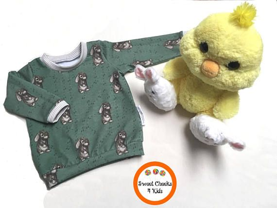 This cute and comfy shirt is green with brown tones in the bunnies and has coordinating sand striped ribbing to make it very stylish. The fabric was designed by a Canadian, inspired by her son's favorite toy 'Bunny Foo Foo'.
