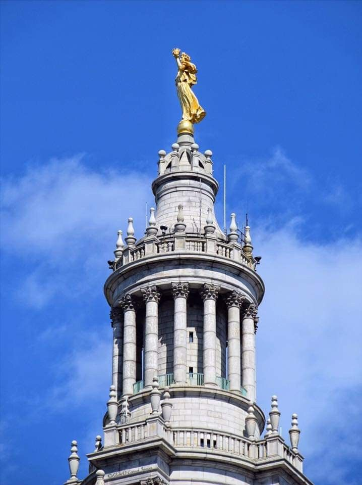 civic fame a gilded copper statue atop the david n dinkins municipal building formerly the manhattan municipal building lower manhattan nyc copper statue a gilded copper statue atop the david n