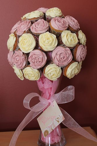A cupcake bouquet would be a great centerpiece as well as a fun way to display dessert!