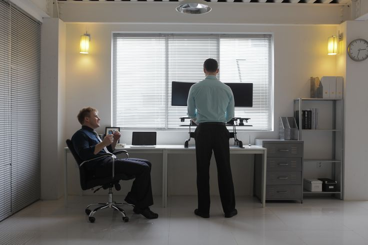 #standuptobackpain - Make a stand today with a VARIDESK. On average a UK citizen sits for 9.5 hours per day and sleeps for 7.3 hours per day. BE DIFFERENT