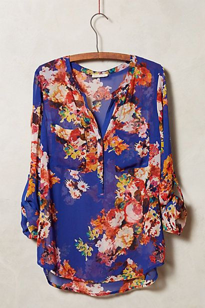 Kennedia Henley - anthropologie.com - love this blue floral flowy top. perfect for hiding the bump