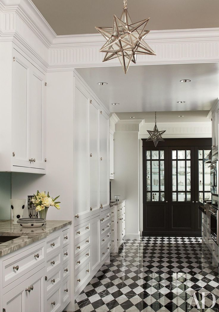 In The Kitchen White Cabinetry By Interior Elements Sets Off Black Door And Checkerboard Floor