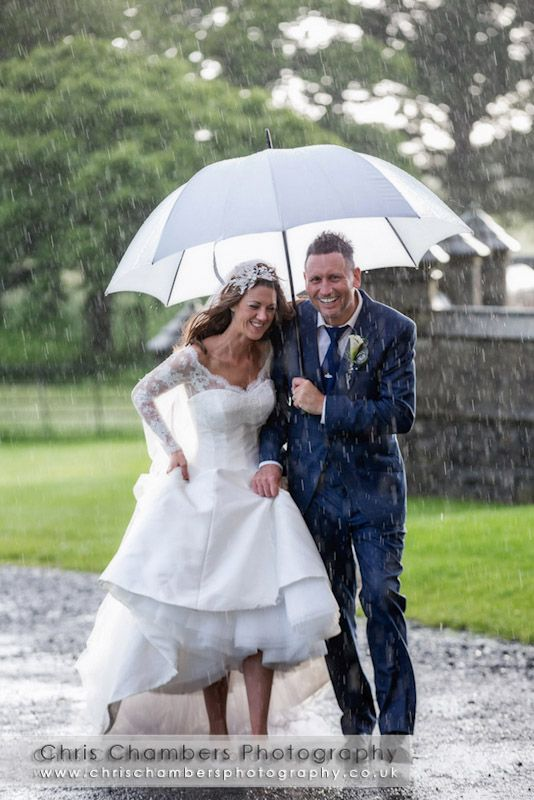 Wet weddings - bride and groom in the rain - Allerton Castle wedding photography from www.chrischambersphotography.co.uk