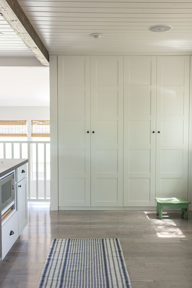 "A Hidden Custom Pantry - A Hidden Custom Pantry  Nothing says ""fancy"" quite like a built-in pantry. These Bergsbo-style IKEA cabinets provide hidden storage in a space that was otherwise a bare wall without a purpose."