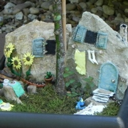 I wasn't home the day the fairies moved in. They stealthily set up camp under the canopy of a gardenia on my back patio. By the looks of the clothesline,...
