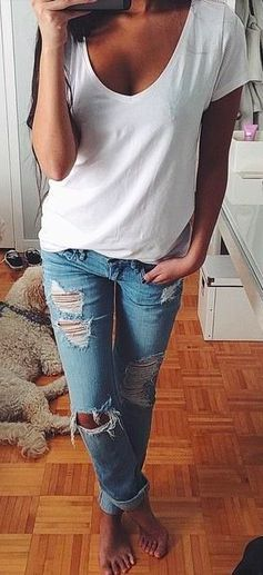 White tee + distressed denim.