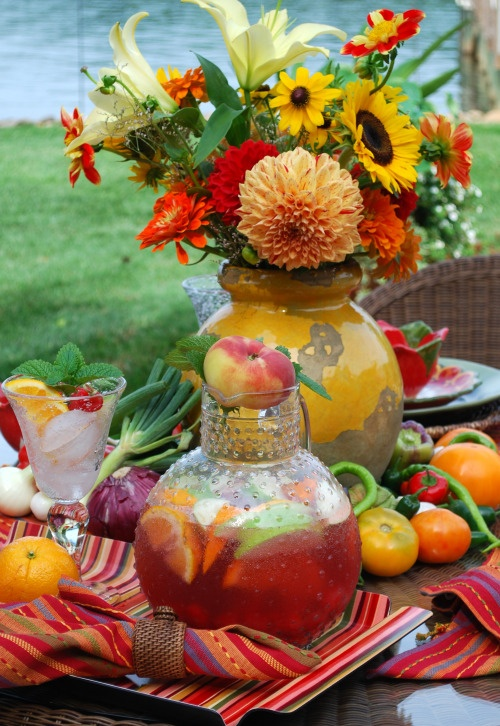 Love the idea of using a peach as a cover/stopper for the sangria pitcher!