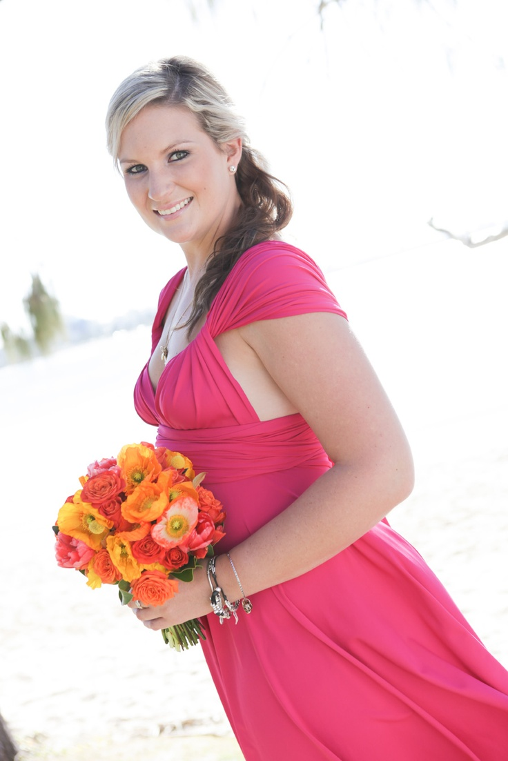 Magenta Convertible Bridesmaid Dress by http://www.lucyandloo.com.au     Wrap and Twist these Convertible Dresses into over 50 different styles. Match your bridesmaids.. or let them style differently to suit their shape.