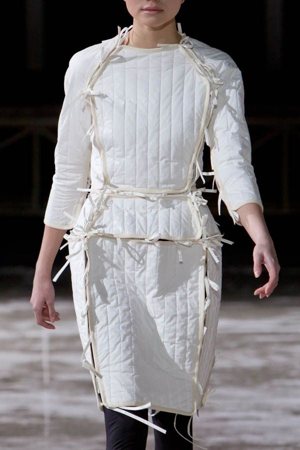 White quilted dress with tied panels; deconstructed fashion details // Nina Donis F/W 2011