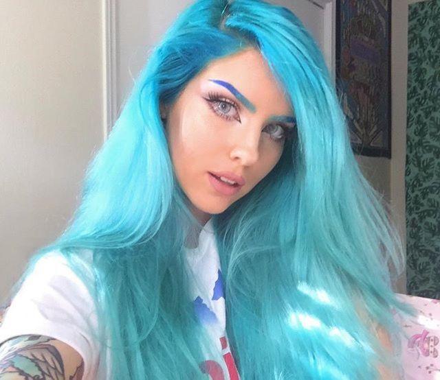 Bright blue aqua hair. Gorgeous. Love her eye makeup too