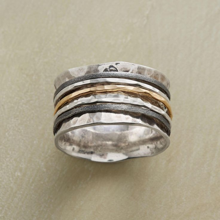 """SPOOLED SPINNER RING--In this mixed-metal spinner ring, five slender rings of sterling silver and 14kt gold spin upon a spooled band of hand-hammered sterling silver. Whole sizes 5 to 9. 1/2""""W. This ring is licensed under U.S. patent no. 6,497,117."""