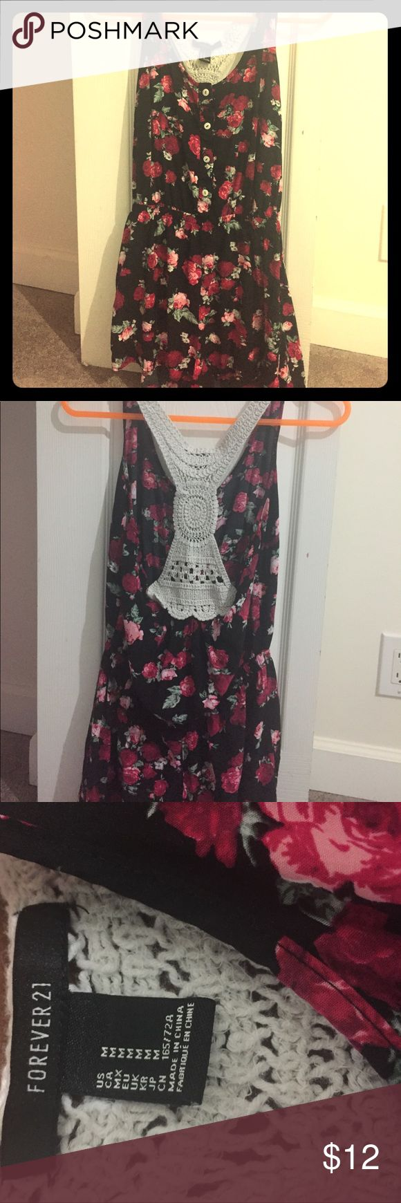 Forever 21 floral romper Black and floral Forever 21 medium romper. Originally bought for $25. Bought in 2014. In really good condition. Forever 21 Dresses Mini