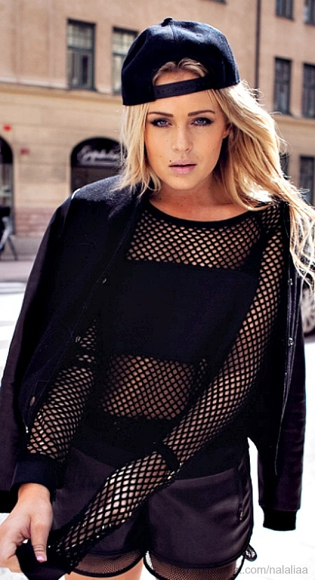 Take this outfit and put it on someone that looks the part. lol. Anyway, love the fishnets.