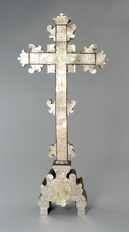 A wood and mother of pearl crucifix, Jerusalem, 19th century,engraved with the body of Christ flanked by saints, the base with a roundel of Saint Anne, 53cm. high - Price Estimate: £200 - £300