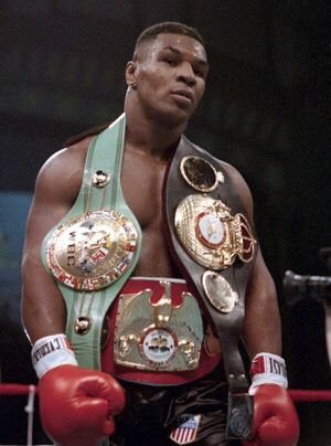 Mike Tyson with belts