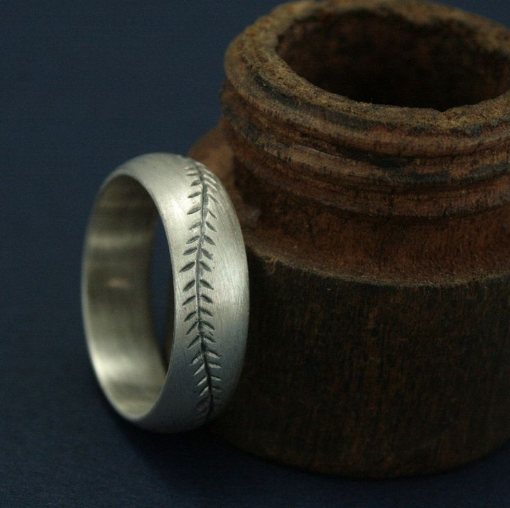 America's Pastime Oxidized Finish--6mm Wide--Sterling Silver--Baseball Ring--Hand Cut Baseball Pattern--Hand Made Ring--Men's Wedding Band by RevolutionBA on Etsy https://www.etsy.com/listing/191031480/americas-pastime-oxidized-finish-6mm