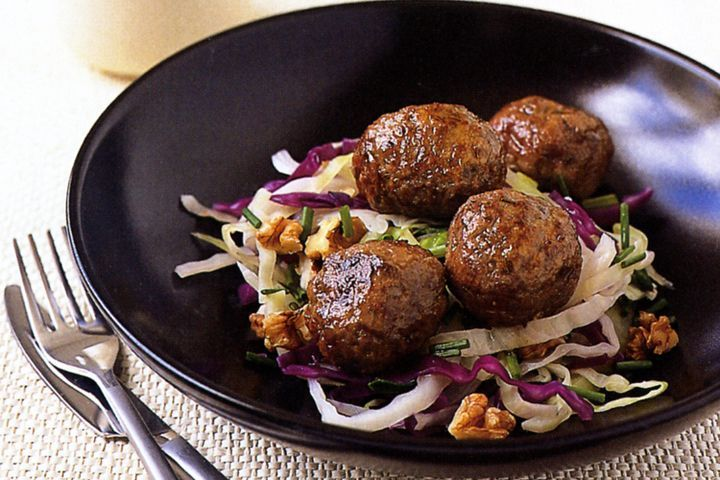 Caraway meatballs with cabbage salad
