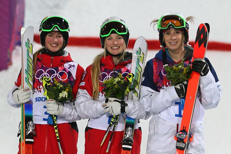 SOCHI, RUSSIA - FEBRUARY 08: (L-R) Silver medalist Chloe Dufour-Lapointe of Canada, gold medalist Justine Dufour-Lapointe of Canada and bronze medalist Hannah Kearney of the United States pose on the podium during the flower ceremony following the Ladies' Moguls Final 3 on day one of the Sochi 2014 Winter Olympics at Rosa Khutor Extreme Park on February 8, 2014 in Sochi, Russia. (Photo by Mike Ehrmann/Getty Images)