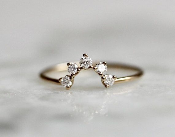 This ring is great as a wedding band or stacking ring. It fits very well with oval and pear shape rings. Each diamond measure 2mm in length (.15 Ct total)  Round Band measures 1mm in width. Hand Crafted out of 14K Yellow, Rose or White gold, The opening space of the chevron is approximately 5mm wide by 4mm in hight. Diamonds are conflict free. *** please note all items are made to order. Please check policies for current processing times.***  Processing times- Current processing time is 1-2…