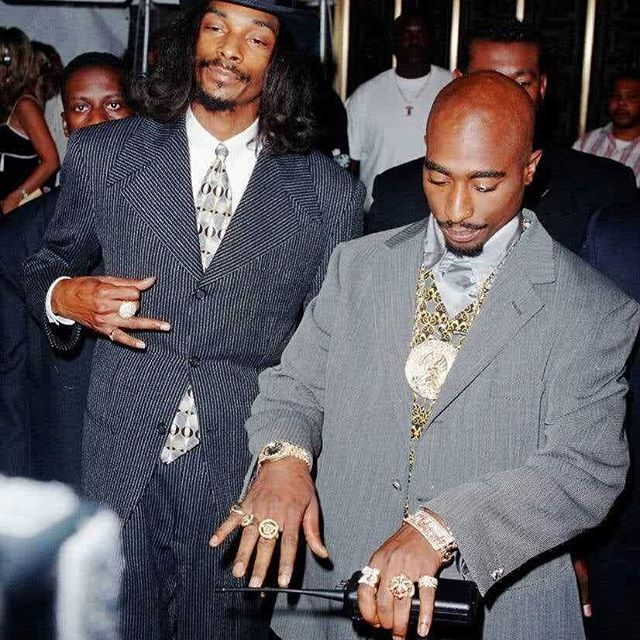Snoop Dogg and Tupac Shakur  Death is for a son to stay free. I'm thugged out. Fuck the world cuz this is how they made me. Scarred but still breathin. Believe in me and you could see the victory. A warrior with jewels. Will you picture me? Life of and outlaw. #2pac #legend