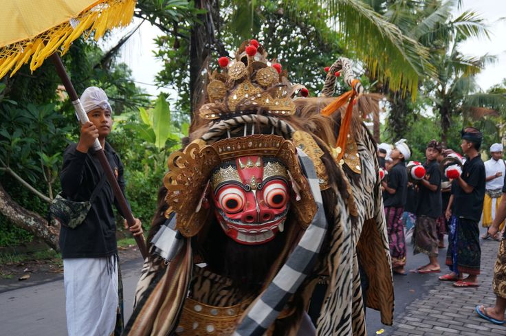 Ngelawang tradition in Bali when people take the Barong to walk around the village over Galungan and Kuningan Festive Celebration