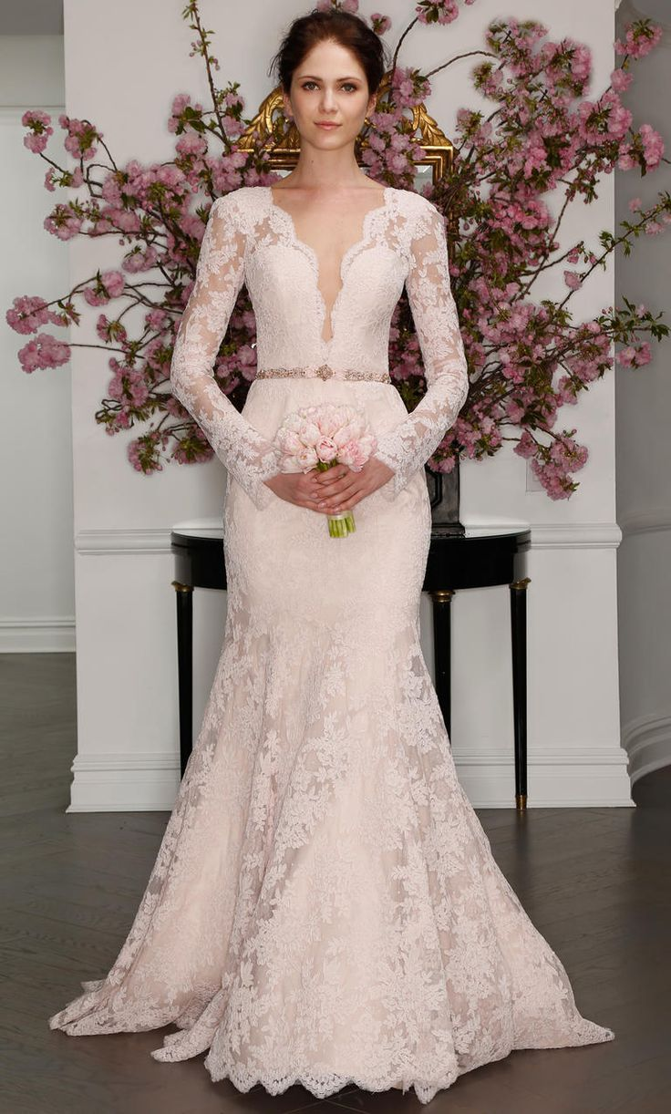 Blush lace gown with plunging neckline and long sleeves | Legends by Romona Keveza Spring 2017 | https://www.theknot.com/content/legends-by-romona-keveza-wedding-dresses-bridal-fashion-week-spring-2017