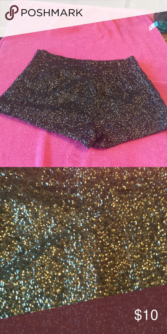 Sexy glitter shorts Let the party start. You will stand out in these black glitter shorts. Statement shorts. Tag says large but fits like a small. Waist about 17 inches. Shorts