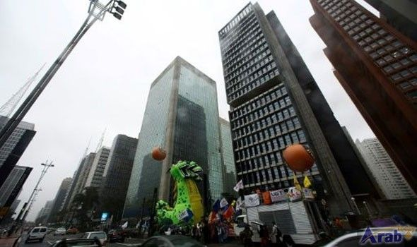 Brazil's central bank cuts key rate to…