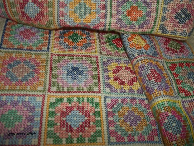 Colorful Granny squares on beige .