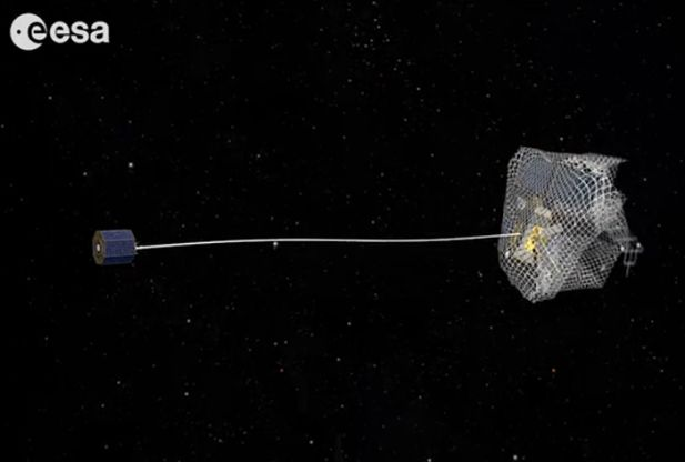 One capture concept being explored through ESA's e.Deorbit system study for Active Debris Removal - capturing the satellite in a net attached to either a flexible tether (as seen here) or a rigid connection. Credit: ESA Read more at http://www.redorbit.com/news/space/1113077234/how-to-catch-a-satellite-022114/#aYS5wgKjEqFygllD.99