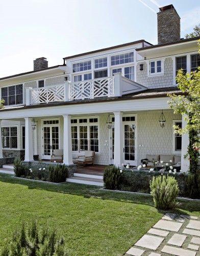 Porch + fretwork railing + landscaping   Tim Barber LTD Architecture & Interior Design