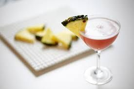This #Skimpy #Paradise #Martini is perfect for either #relaxing or #playing on your #SundayFunday!!  #Recipe   1oz #Pomegranate flavored #vodka  2oz Skimpy #Pineapple  Splash of #Cranberry Juice   Shake 1st two ingredients together then add a splash of Cranberry juice and garnish with a slice of pineapple or a cherry.