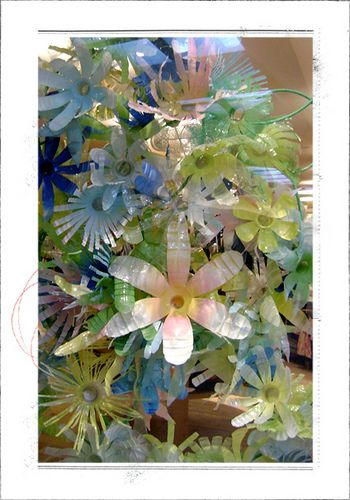 So eco-crafty - water bottle flowers from Anthropologie store display