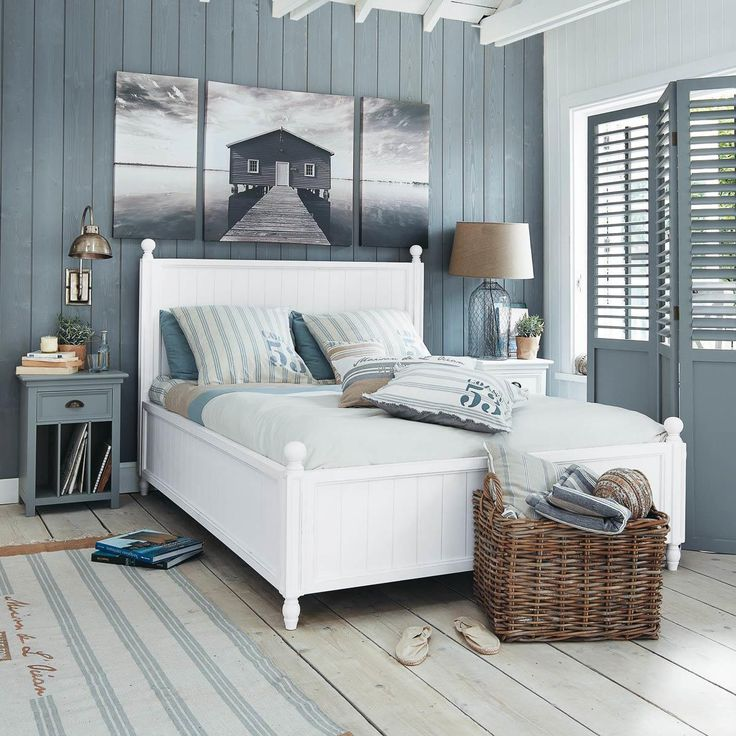 Love the wood wall and the artwork above the bed. This room has a casual, coastal feel.