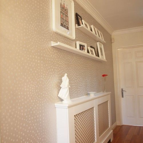 Narrow hall with radiator cover and picture ledge